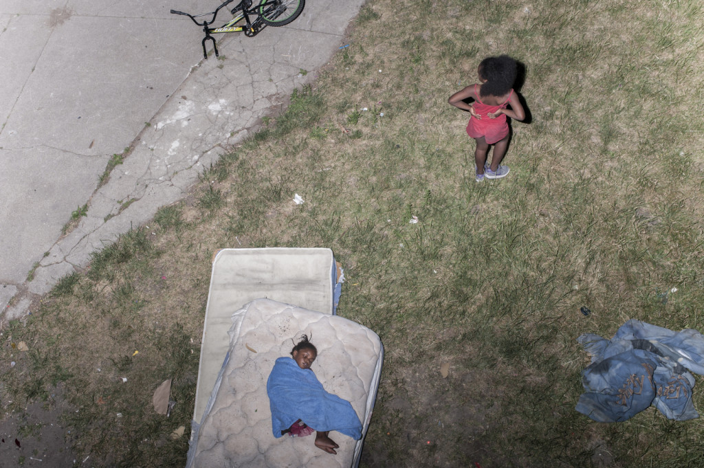 2012. USA.  Detroit, MI.  Sleeping outside on a hot summer day in East Detroit.