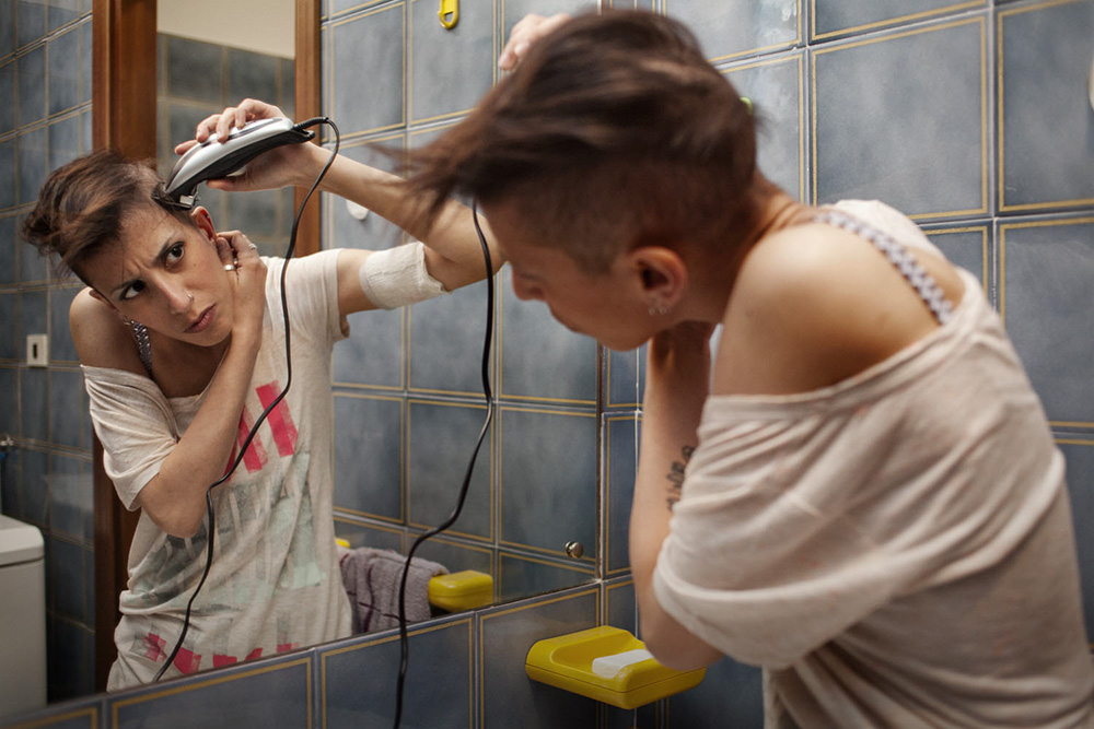 Rome. Federica shaves off her head before all of her hairs falls. Federica is fighting against colon cancer.